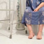woman on toilet after hip surgery