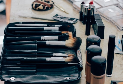 makeup and brushes on vanity
