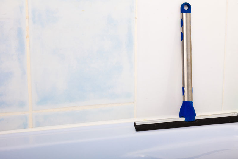 Squeegee for cleaning shower tile