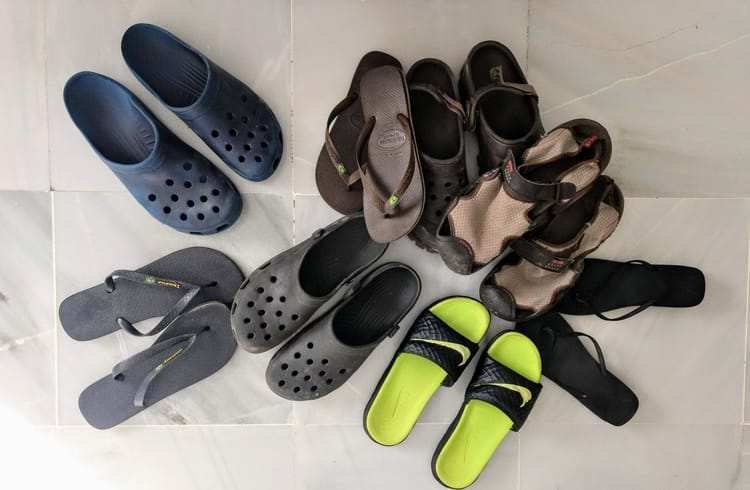 pile of different water shoes