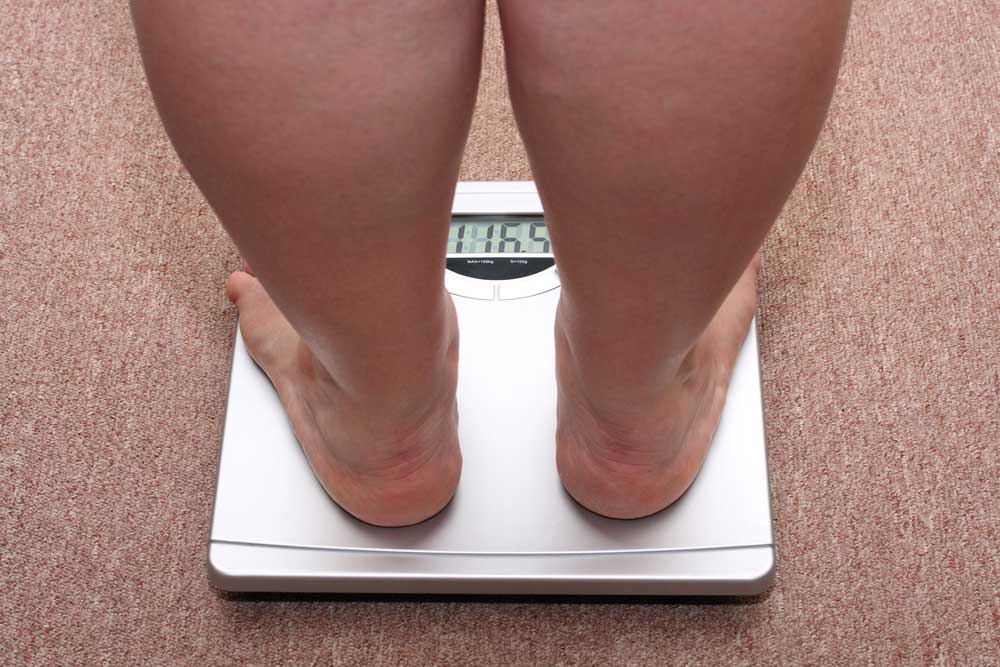 heavy person on high capacity bathroom scale