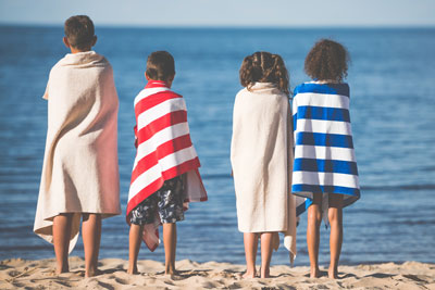 kids wrapped in beach towels