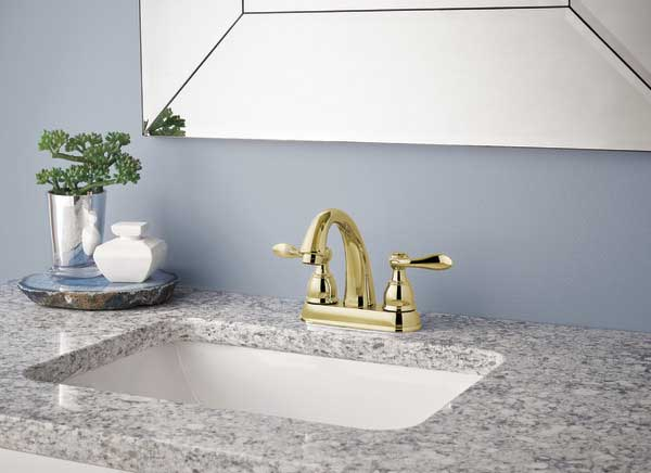 polished brass bathroom faucet with two handles