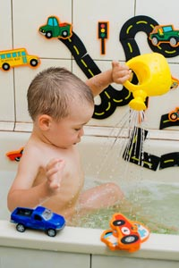 baby boy with bath toys, trucks, cars