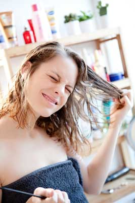 woman with tangled hair from hard water