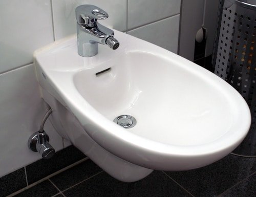 porcelain bidet attached to wall