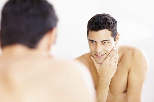 Man looking at a mirror