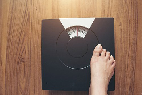 Foot standing on the weighing scale