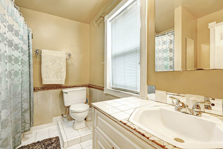 Old style bathroom interior with white tile floor