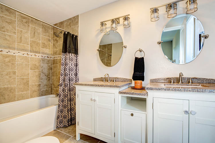 Bathroom detail. Vanity with dual sink and white cabinets