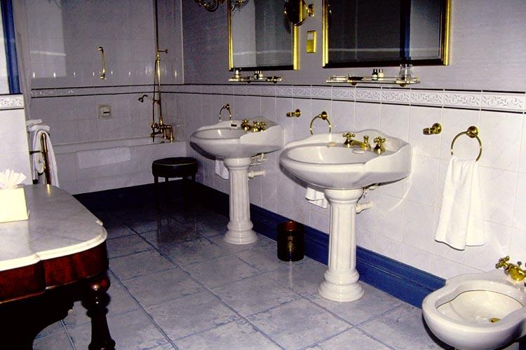 Elegant washroom with pedestal sinks