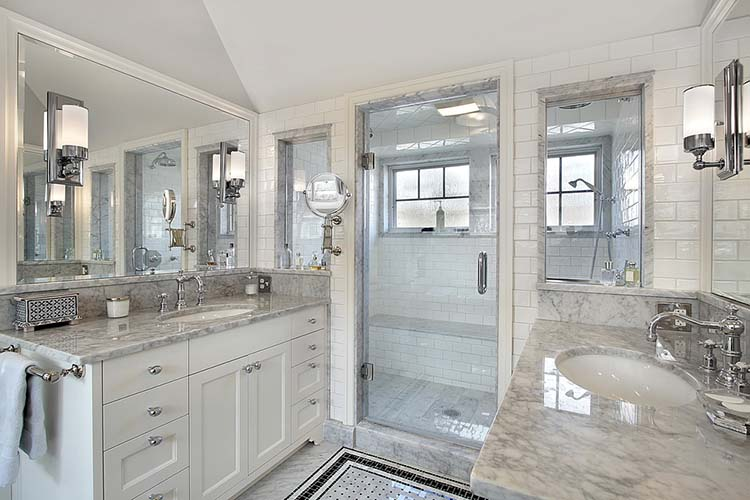 Master bath in luxury home with windowed shower