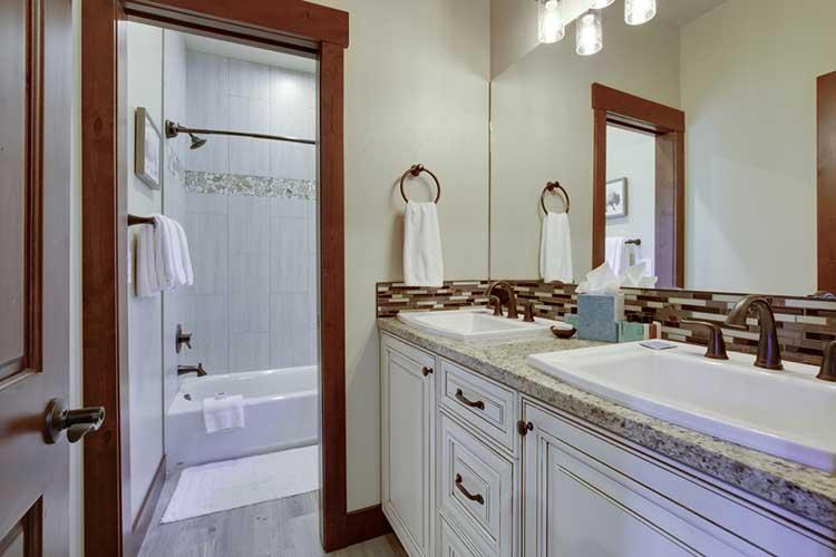 New luxury bathrooms with rich color wooden doors, natural beige